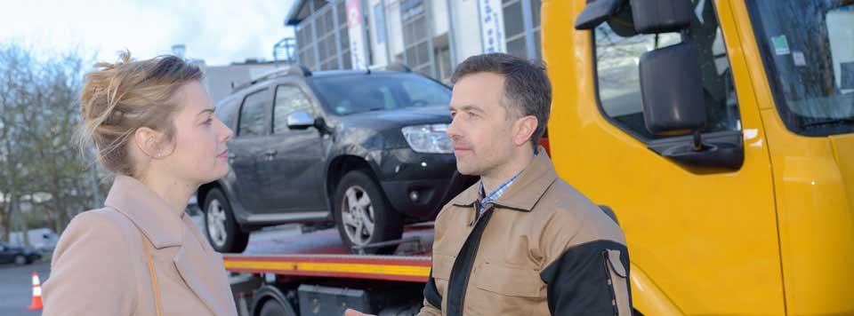 A good tow truck driver reassuring an anxious person