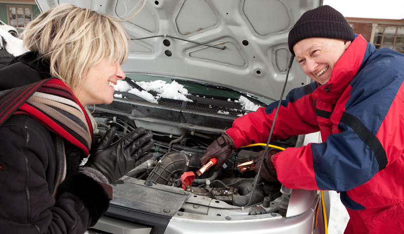 A friendly expert providing assistance in jump starting a vehicle in the Melbourne area