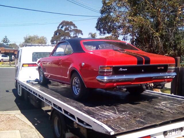 Show car towing service; towing a Holden Monaro.