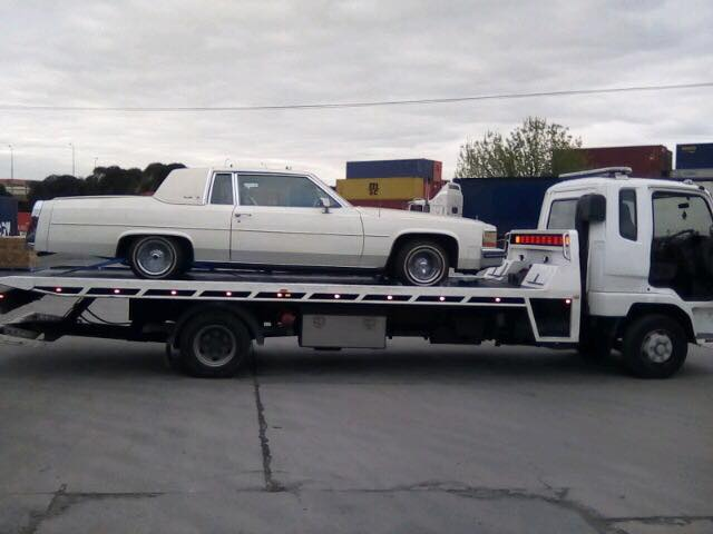 towing of a classic car in Melbourne Australia with a standard tilt tray.