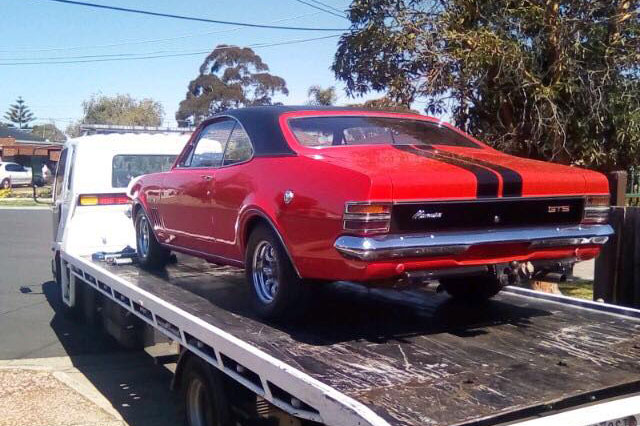 The tilt tray tow of a classic Monaro in Melbourne Australia.