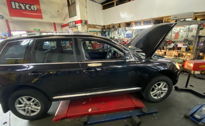 An SUV being repaired at a shop.