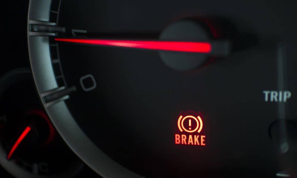 Dashboard showing brake warning light.